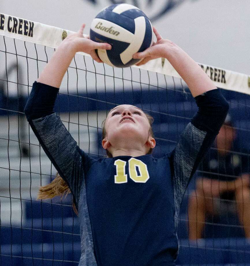 Lake Creek setter Lauren Greene (10) sets the ball during the second set of a District 20-5A high school volleyball match at Lake Creek High School, Tuesday, Oct. 22, 2019, in Montgomery. Photo: Jason Fochtman, Houston Chronicle / Staff Photographer / Houston Chronicle