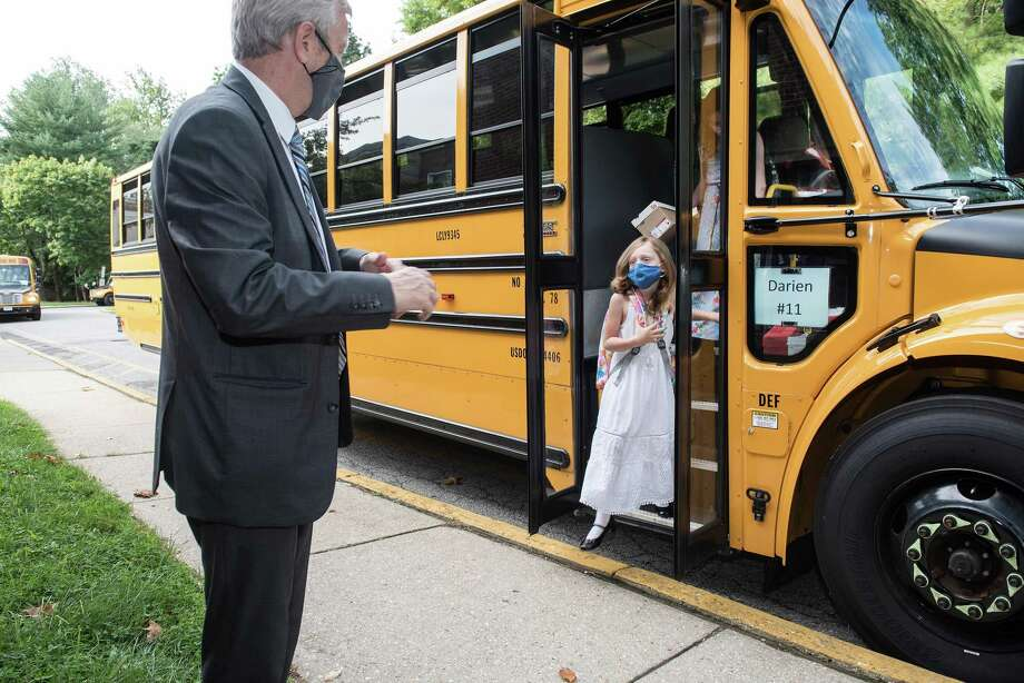 Darien Schools went back to school in a hybrid plan on Thursday, Sept. 3. Schools Superintendent Dr. Alan Addley road the bus with Hindley students for their first day. Photo: Bryan Haeffele/Hearst Connecticut Media / BryanHaeffele
