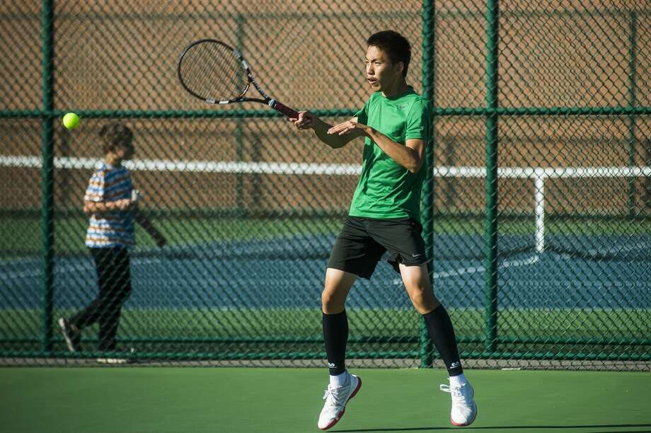 Dow High's Caleb Qiu returns a shot during a Sept. 26, 2019 match against Midland High. Photo: Daily News File Photo