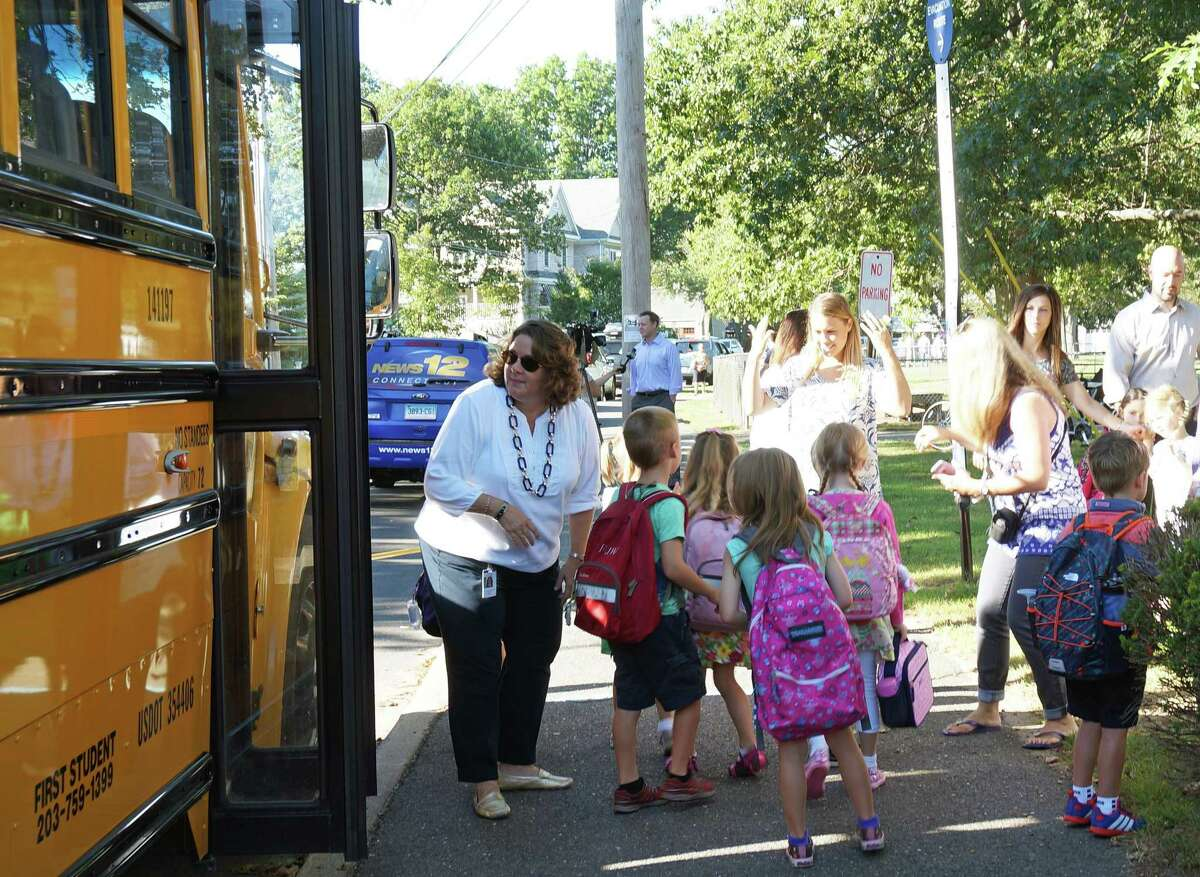 School buses arrive at Sherman School for the first day of the 2019 school year.