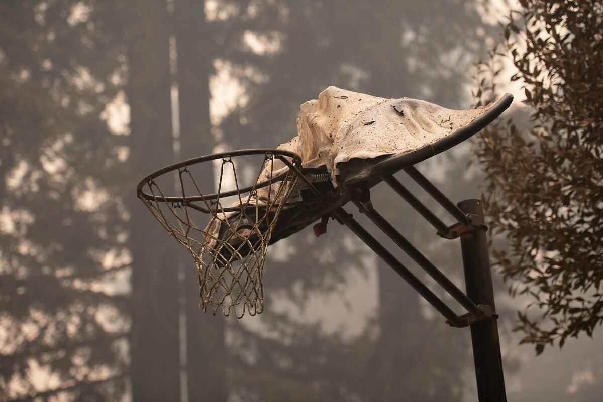 A melted basketball hoop still stands in the driveway of a home on Acorn Drive in Boulder Creek on Aug. 22, 2020. The house was destroyed by the CZU Lightning Complex Fire.