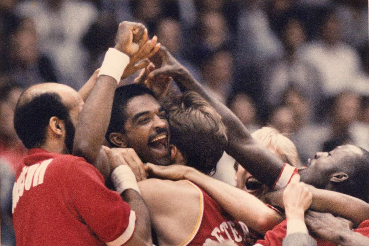 Ralph Sampson is mobbed by his Rockets teammates after his Game 5 buzzer-beating shot to beat the Lakers and send his team to the 1986 NBA Finals.