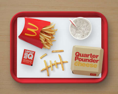 The Travis Scott meal includes the Quarter Pounder with cheese, fries with BBQ sauce to dip and a Sprite.
