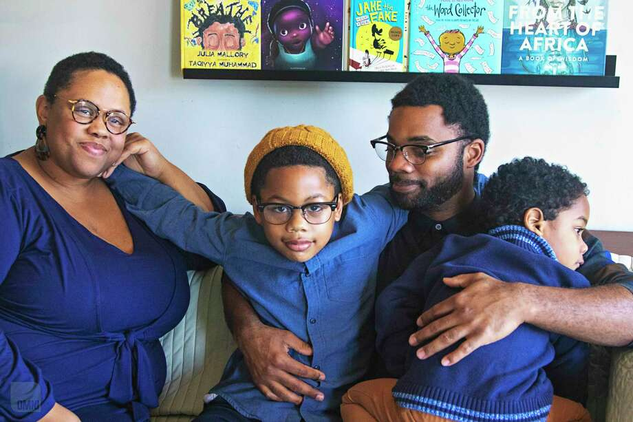 Victoria Scott-Miller, with husband Duane and sons Langston and Emerson. Photo: Jamila R. Davenport/OmniDocs. / Jamila R. Davenport/OmniDocs