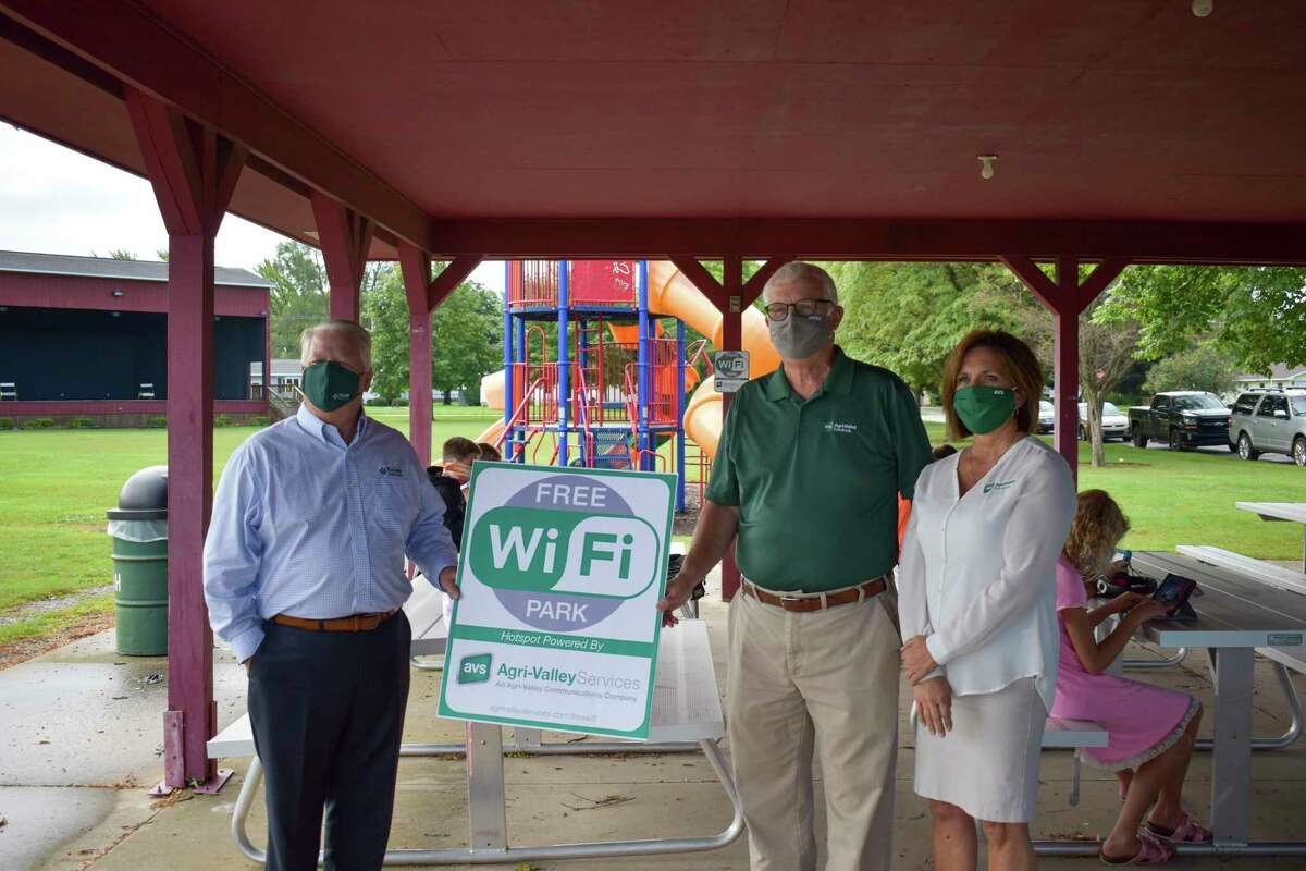 Pigeon Mayor Michael LePage joined Ed Eichler, president and CEO of Agri-Valley Communications, and Barb Main, manager of Agri-Valley Services, to launch a new free Wi-Fi service in Pigeon's Recreation Park. (Paige Withey/Huron Daily Tribune)