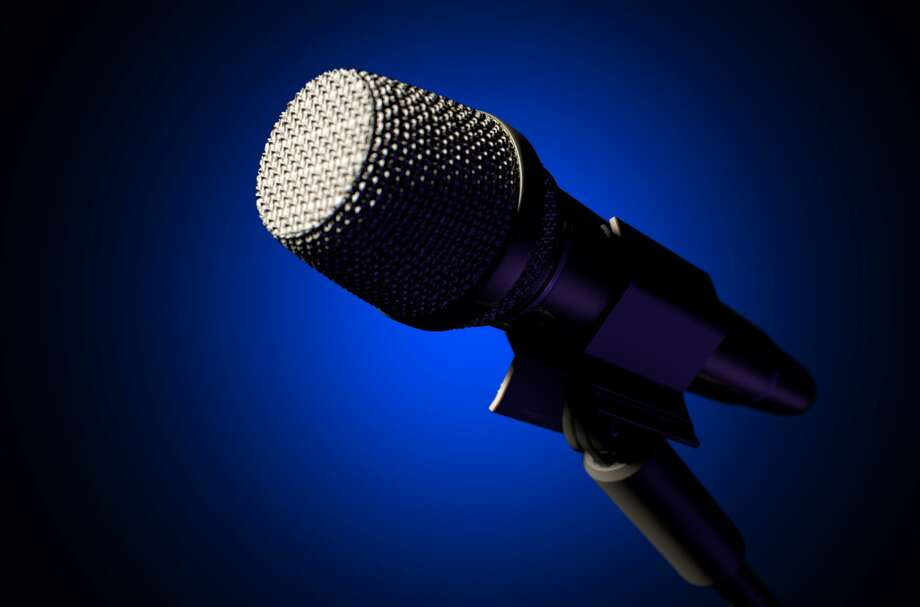 A black metal microphone on a mic stand on an isolated dark background - 3D Render Photo: Allanswart/Getty Images/iStockphoto