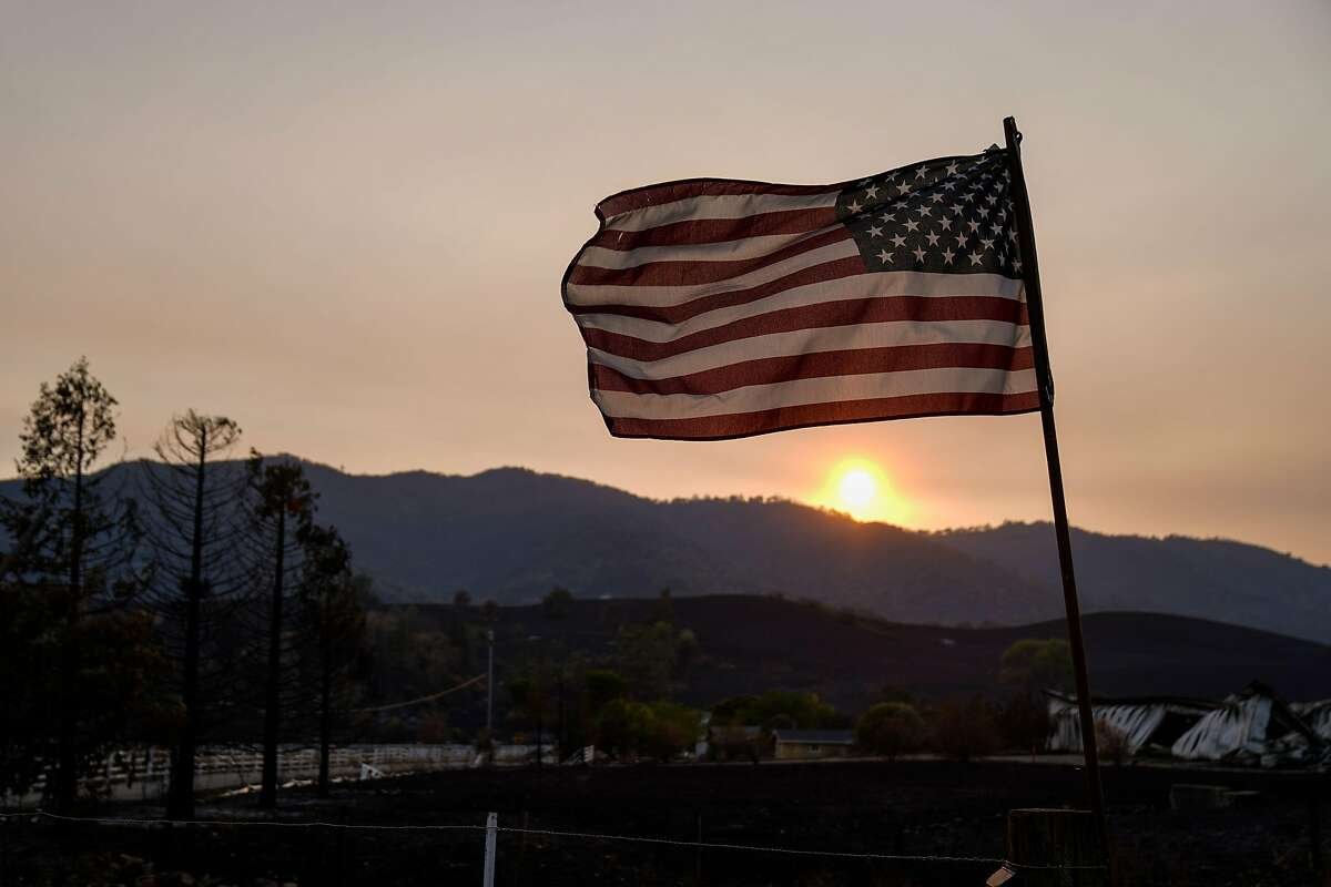 VACAVILLE, CA - AUGUST 24: An American flag is seen, fastened to a burnt post along Cantelow Road where the LNU Lightning complex fire tore through last week, photographed on Monday, Aug. 24, 2020 in Vacaville, CA. (Kent Nishimura/Los Angeles Times/TNS)