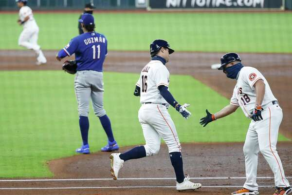 Houston Astros Aledmys Diaz (16) celebrates his three-run home run with first base coach Omar Lopez during the first inning of an MLB baseball game at Minute Maid Park, Thursday, September 3, 2020, in Houston.