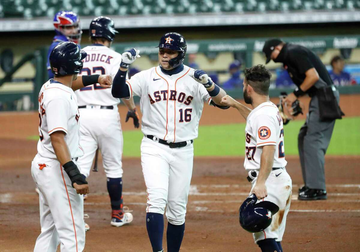 Houston Astros Aledmys Diaz (16) celebrates his three-run home run with Michael Brantley (23) and Jose Altuve (27) during the first inning of an MLB baseball game at Minute Maid Park, Thursday, September 3, 2020, in Houston.