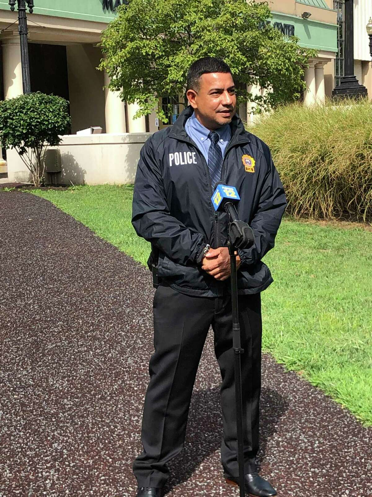 Bridgeport homicide Detective Jorge Cintron helped deliver a baby for a couple stopped at an intersection on their way to the hospital because the baby didn't wait.