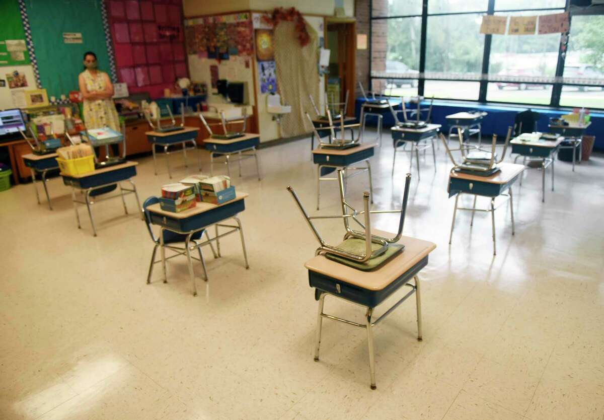 Desks are spaced six feet apart in a classroom at Springdale Elementary School in Stamford, Conn. Tuesday, Sept. 1, 2020. Tuesday marked the first offical day of Stamford teachers' return to school to get their classrooms ready for the upcoming 2020-2021 school year.