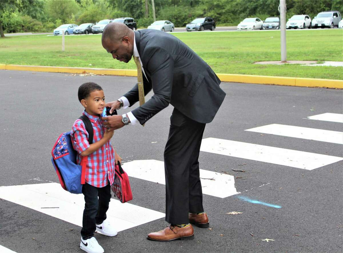 Middletown Superintendent of Schools Michael Conner says goodbye to his 5-year-old son Michael Jr. at Lawrence Elementary School Thursday morning.