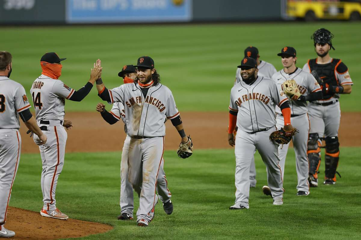 DENVER, CO - SEPTEMBER 01: Brandon Crawford #35 of the San Francisco Giants leads the team off the field as the team celebrates their 23-5 win against the Colorado Rockies at Coors Field on September 1, 2020 in Denver, Colorado. (Photo by Justin Edmonds/Getty Images)