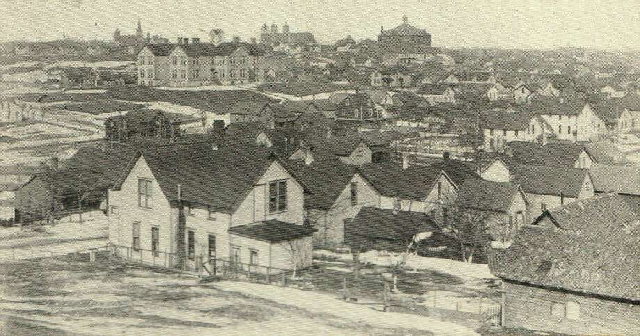 A look at part of the city landscape, with St. Joseph Church seen in the distance, circa 1910. (Manistee County Historical Museum photo)