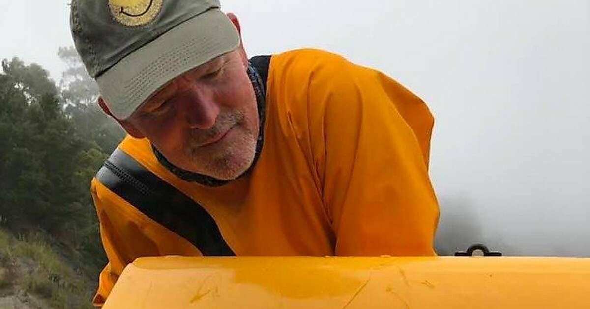 David Alexander, a school administrator, surveys the bite marks on the front of his kayak after a great white shark took the front of the boat in its mouth