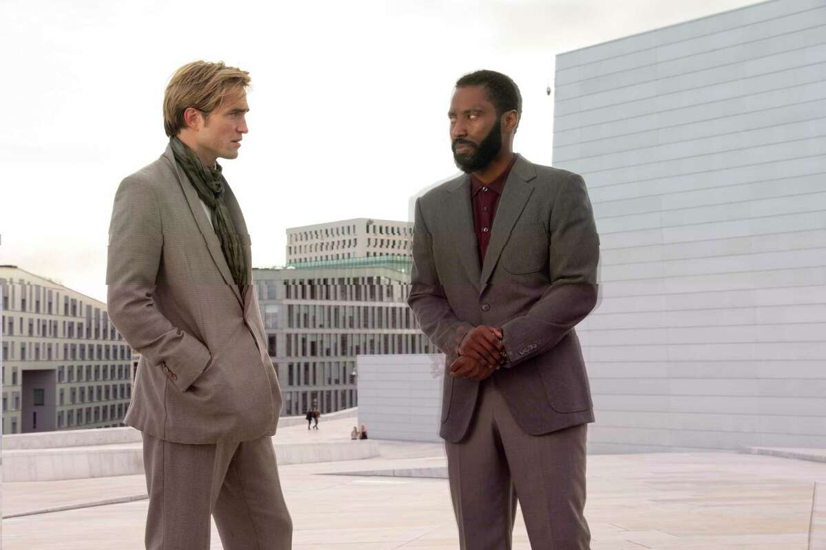 This image released by Warner Bros. Entertainment shows Robert Pattinson, left, and John David Washington in a scene from