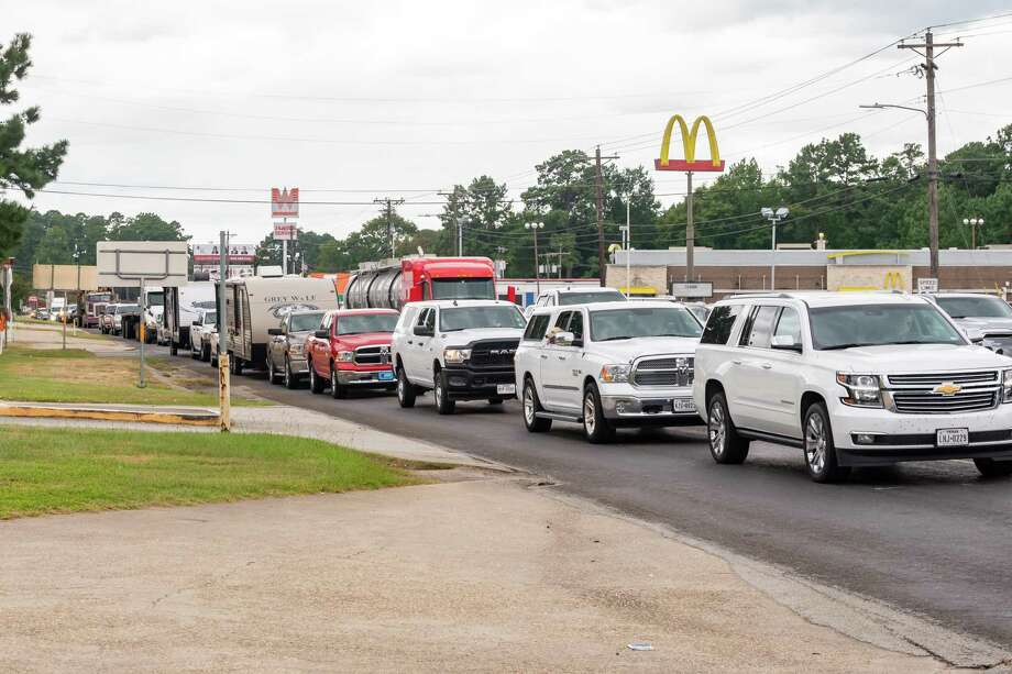 Evacuation traffic backs up in Jasper where US 190 & US 69. The northbound line of vehicles stretched through town on Tuesday afternoon. The largely rural, pine-canopied communities of Jasper and Newton counties find themselves facing a threat more common to coastal communities Photo made on August 25, 2020. Fran Ruchalski/The Enterprise Photo: Fran Ruchalski, The Enterprise / The Enterprise / © 2020 The Beaumont Enterprise