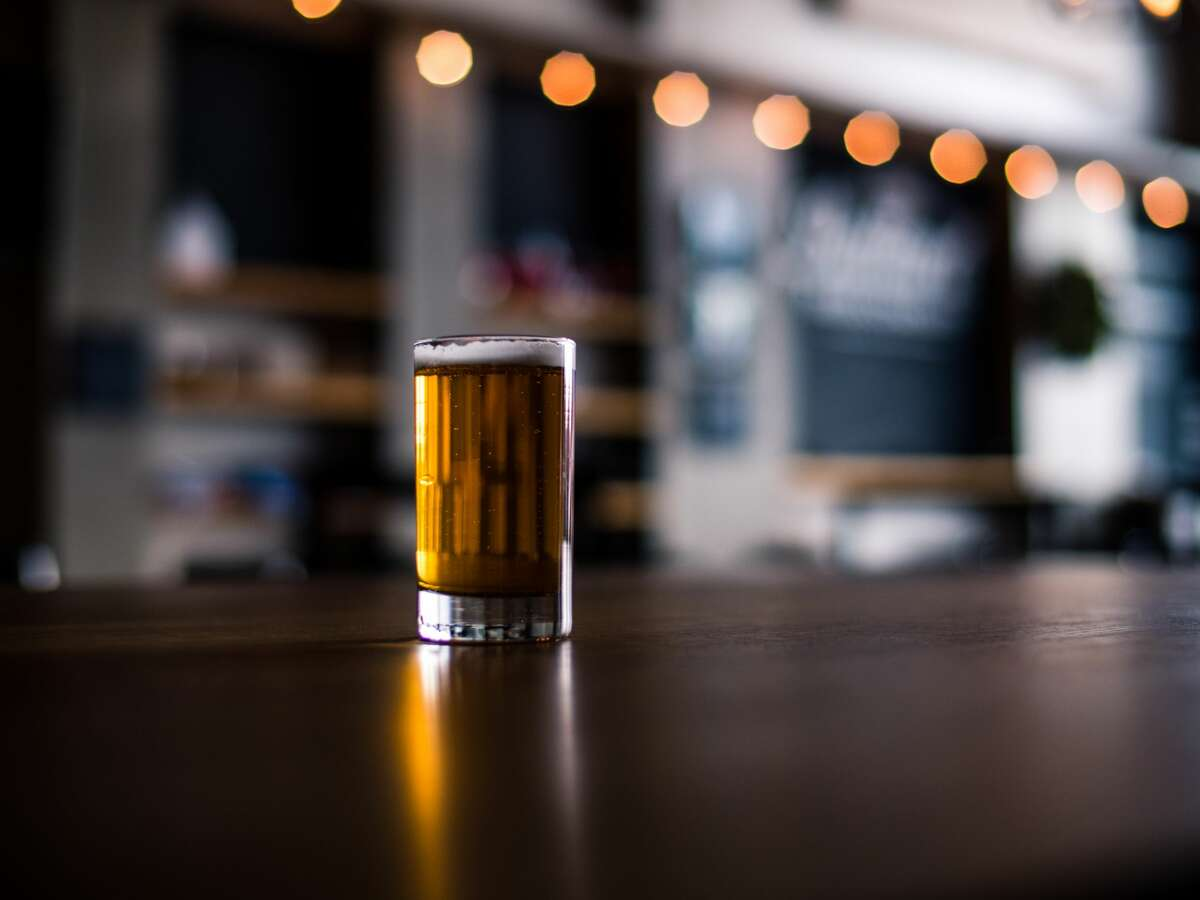 File image of a glass of beer atop a bar.