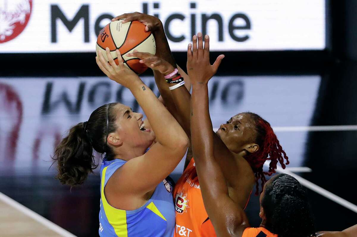 Connecticut Sun guard Bria Holmes, right, blocks a shot by Chicago Sky center Stefanie Dolson during the first half of a WNBA basketball game Friday, Aug. 14, 2020, in Bradenton, Fla. (AP Photo/Chris O'Meara)