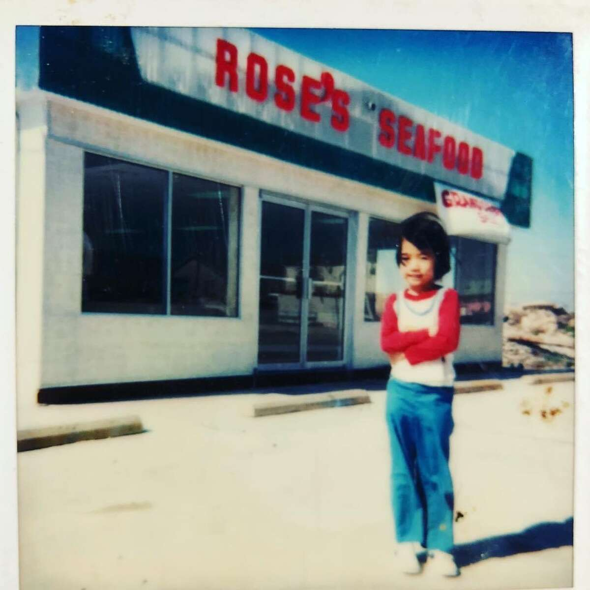 Samantha Tran as a child standing in front of the family business; Tran, now 43, manages the seafood market in Seabrook.