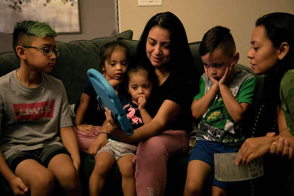 Vanessa, with her twins, Olivia and Sophia, and her son, Aiden, are joined by her sister, Alex, right, and Alex's son, Fabian Vasquez, 8, left, on a video call with Nora.