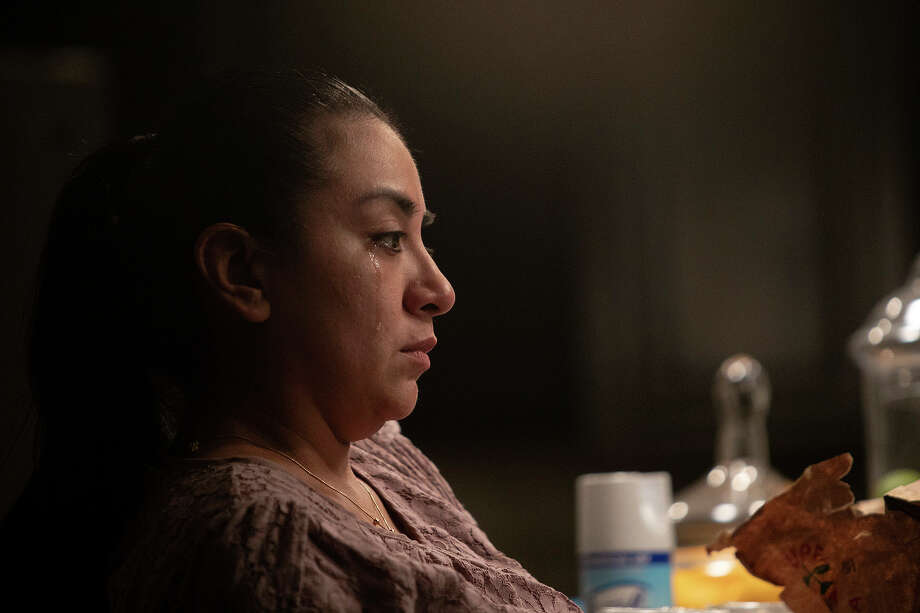 Vanessa grieves the loss of her mother, Nora. Vanessa and her brother Andy were able to see their mother in person the evening before she died. Photo: Lisa Krantz, Staff Photographer / San Antonio Express-News
