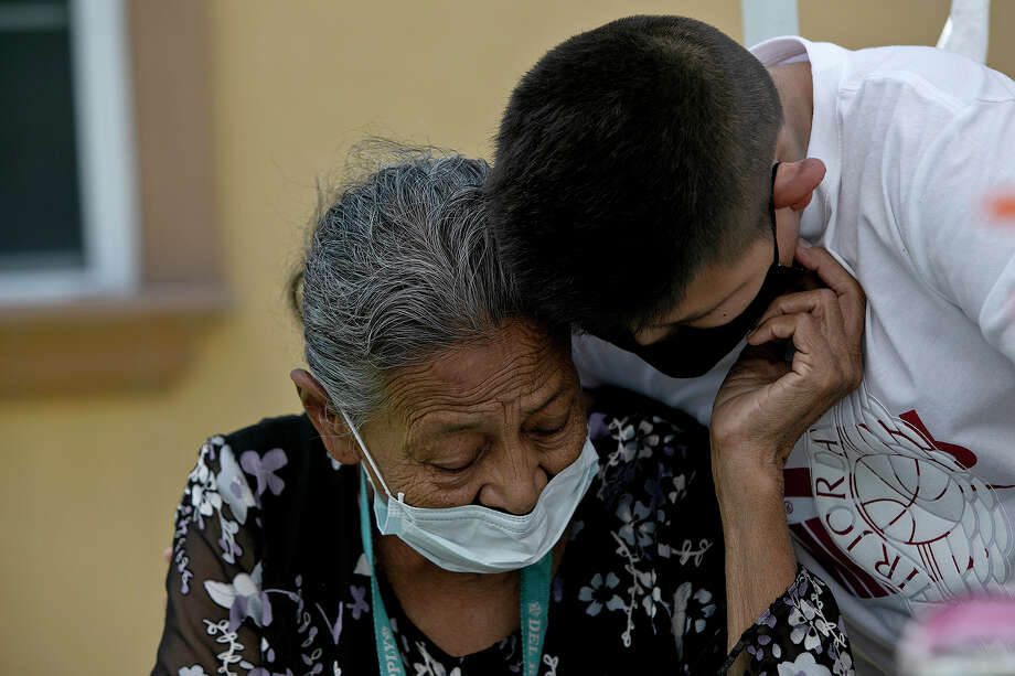 Felicitas Rangel, Enrique's mother and Nora's mother-in-law, shares a moment with Miguel Hernandez during lunch Alex's home after Nora's funeral. Nora and Enrique had been married nearly 44 years. Photo: Lisa Krantz, Staff Photographer / San Antonio Express-News
