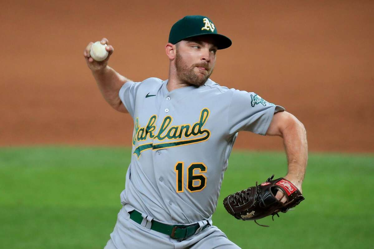 ARLINGTON, TEXAS - AUGUST 26: Liam Hendriks #16 of the Oakland Athletics pitches against the Texas Rangers in the bottom of the ninth inning at Globe Life Field on August 26, 2020 in Arlington, Texas. (Photo by Tom Pennington/Getty Images)