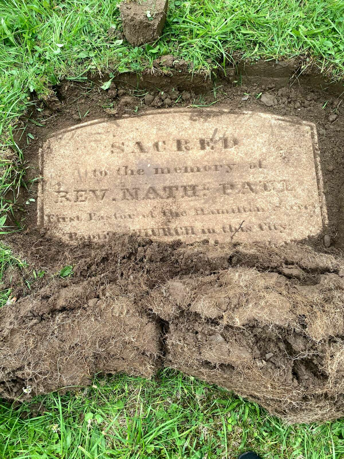 Part of the gravestone for the Rev. Nathaniel Paul, who arrived in Albany in 1820 as the founding pastor of what would become First African Baptist Church. Gravestone restorer Chris White and cemetery historian Paula Lemire unearthed the marker earlier this week in Albany Rural Cemetery in Menands. It is presumed to have been buried for a century or more after  being toppled or falling over. (Provided photo.)