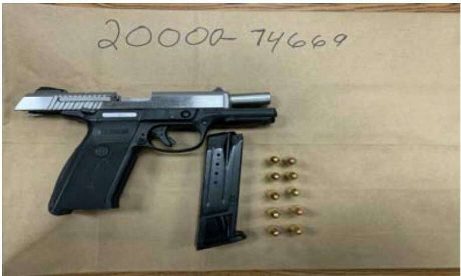 A 9 mm handgun and ammunition Bridgeport police said they recovered during a SWAT raid on a city apartment Thursday, Sept. 3 2020 Photo: Contributed /Bridgeport Police Department