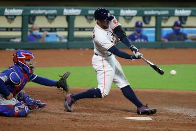 Houston Astros George Springer (4) singles during the eighth inning of an MLB baseball game at Minute Maid Park, Thursday, September 3, 2020, in Houston.