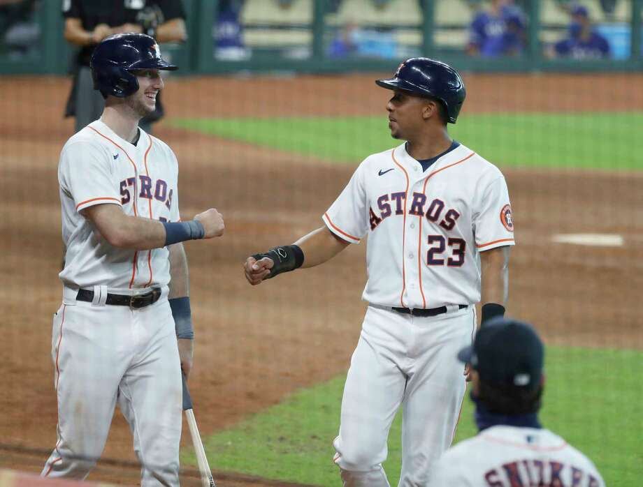 Houston Astros Michael Brantley celebrates with Kyle Tucker after his RBI double during the eighth inning of an MLB baseball game at Minute Maid Park, Thursday, September 3, 2020, in Houston. Photo: Karen Warren, Staff Photographer / © 2020 Houston Chronicle