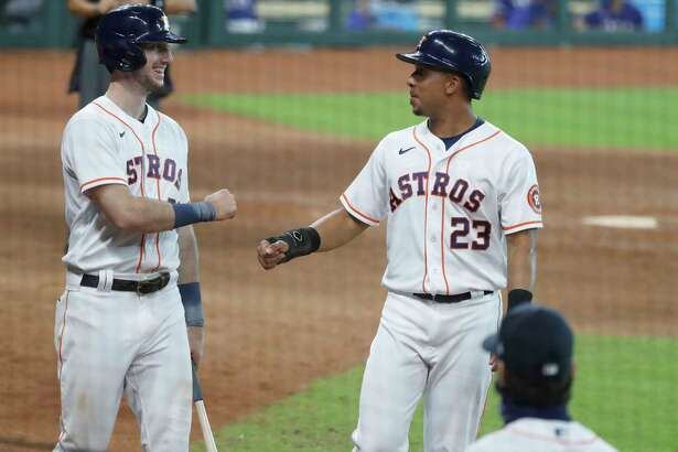 Houston Astros Michael Brantley celebrates with Kyle Tucker after his RBI double during the eighth inning of an MLB baseball game at Minute Maid Park, Thursday, September 3, 2020, in Houston.