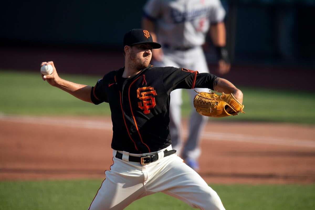 San Francisco Giants starting pitcher Kevin Gausman (34) delivers a pitch against the Los Angeles Dodgers during the third inning of a baseball game on Thursday, Aug. 27, 2020 in San Francisco, Calif.