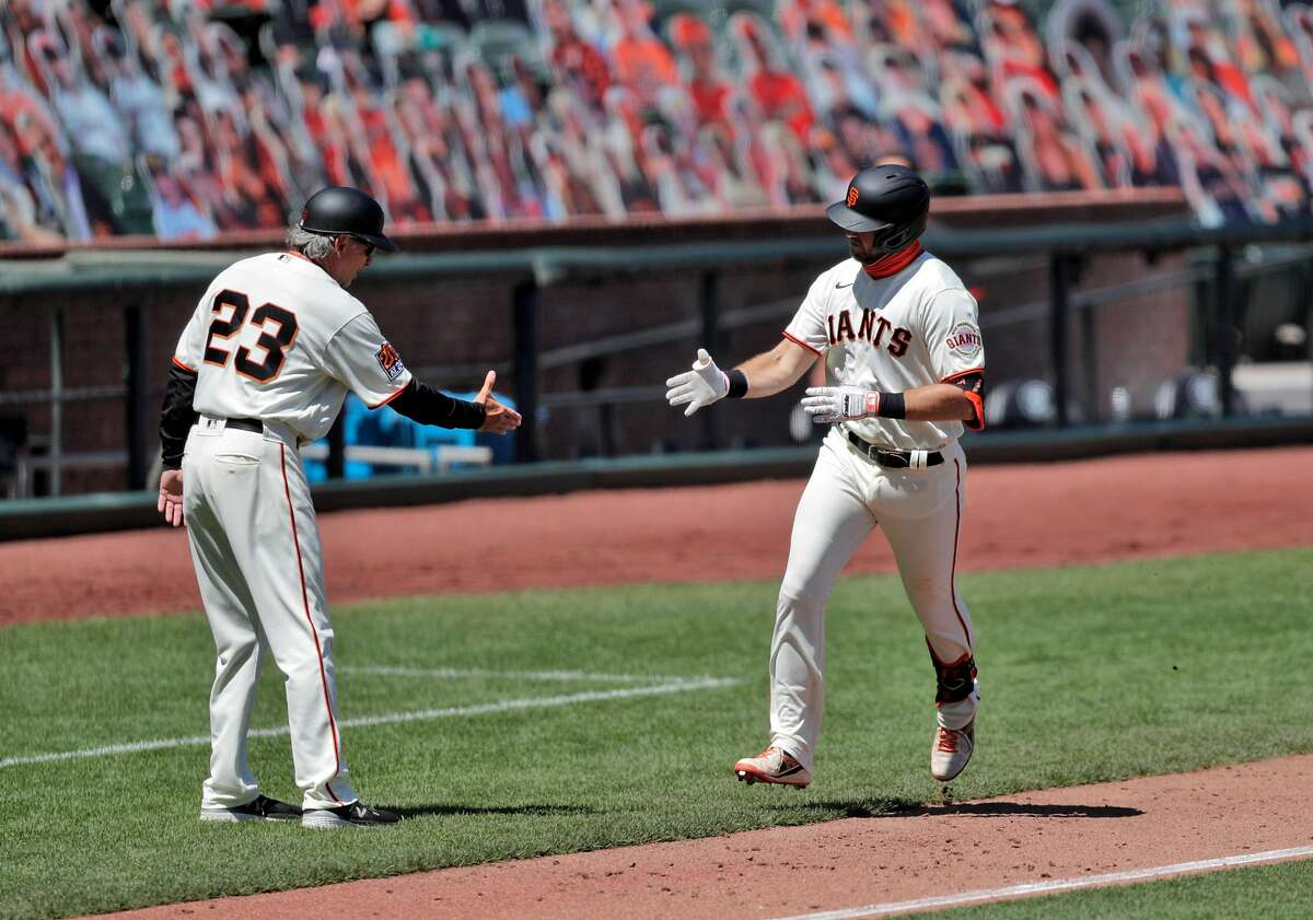 Evan Longoria (10) gestures toward third base coach Ron Wotus after hittinga solo homerun in the sixth inning as the San Francisco Giants played the Texas Rangers at the Oracle Park in San Francisco, Calif., on Sunday, August 2, 2020.