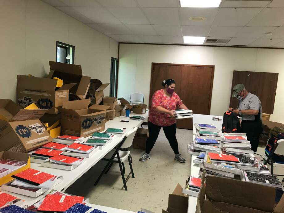 Volunteers from First Presbyterian Church of Alvin fill backpacks with school supplies, preparing them for students in Pearland and Alvin ISDs. Photo: Courtesy Vic Coppinger YMCA / Courtesy Vic Coppinger YMCA