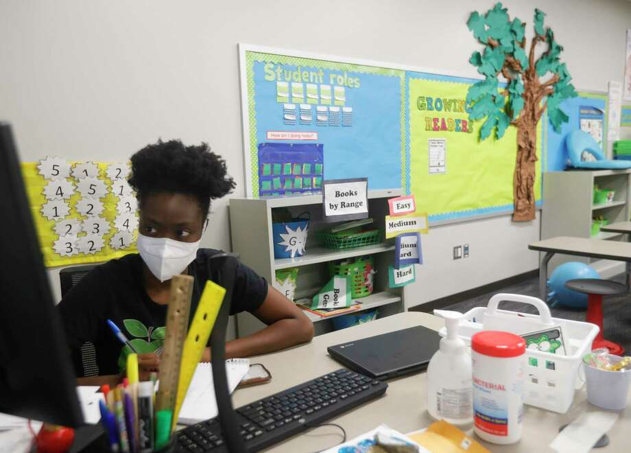 First grade teacher Eboni Roberson takes part in staff development as teachers at Suchma Elementary School prepare for the upcoming school year where they will begin instructing students remotely from their classrooms, Thursday, Aug. 6, 2020, in Conroe. This year, teachers have also been given new training from district counselors on how to address a student in crisis in the remote learning classroom. Counselors are seeing an increase in student stress due to isolation. Photo: Jason Fochtman, Houston Chronicle / Staff Photographer / 2020 © Houston Chronicle