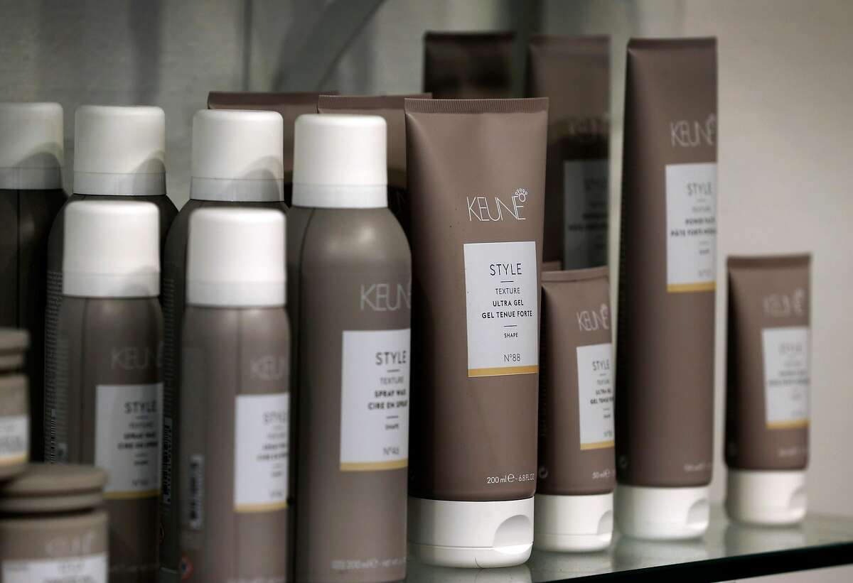 Hair care product is displayed on shelves at Orabella Hair Studio in Oakland, Calif. on Wednesday, Aug. 26, 2020. Alicia Orabella has decided against reopening her small studio when Alameda County loosens restrictions on hair salons Friday allowing them to operate outdoors only.