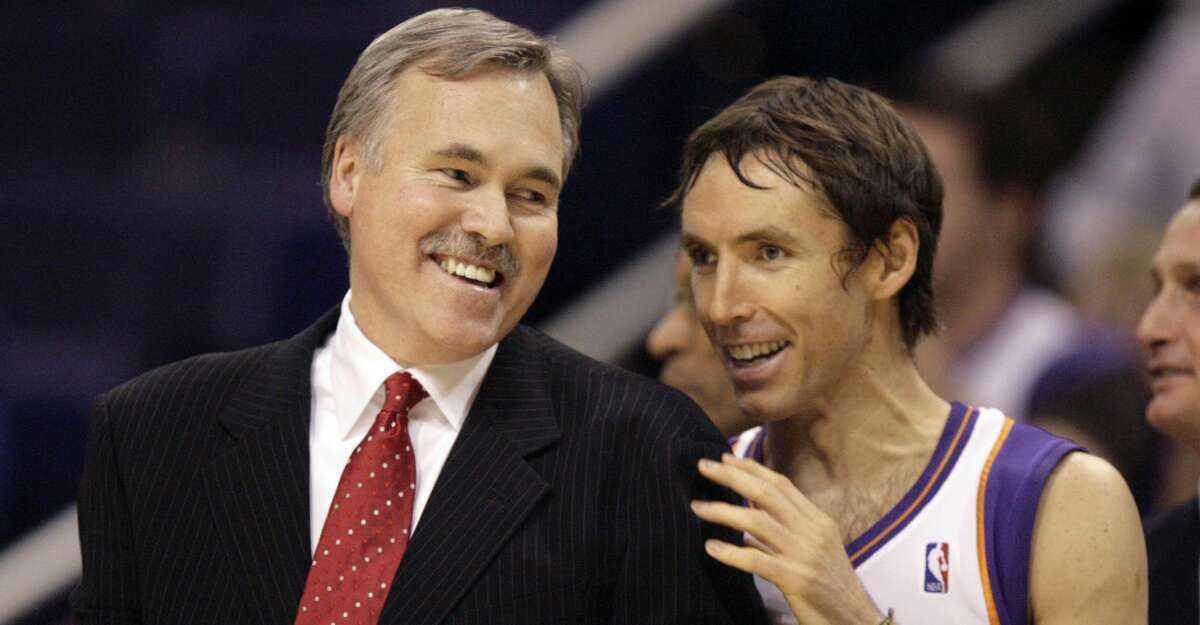 New York Knicks coach Mike D'Antoni, left, is greeted by Phoenix Suns guard Steve Nash, right, prior to an NBA basketball game Monday, Dec. 15, 2008, in Phoenix. (AP Photo/Paul Connors)