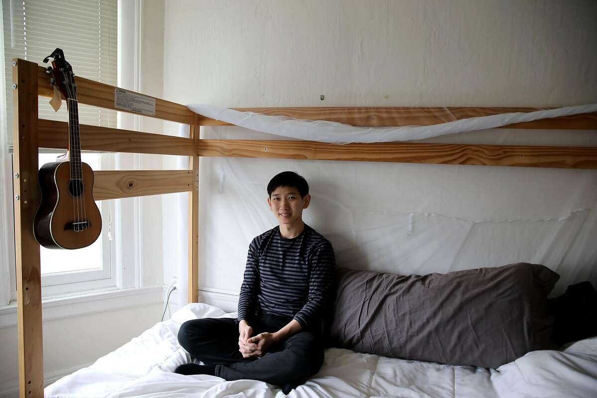 """Chaowat """"Pong"""" Lertsachanant poses for a portrait inside his apartment on Tuesday, September 1, 2020, in San Francisco, Calif. Pong is the visual development artist who illustrated the covers for The Throughline section in the San Francisco Chronicle."""