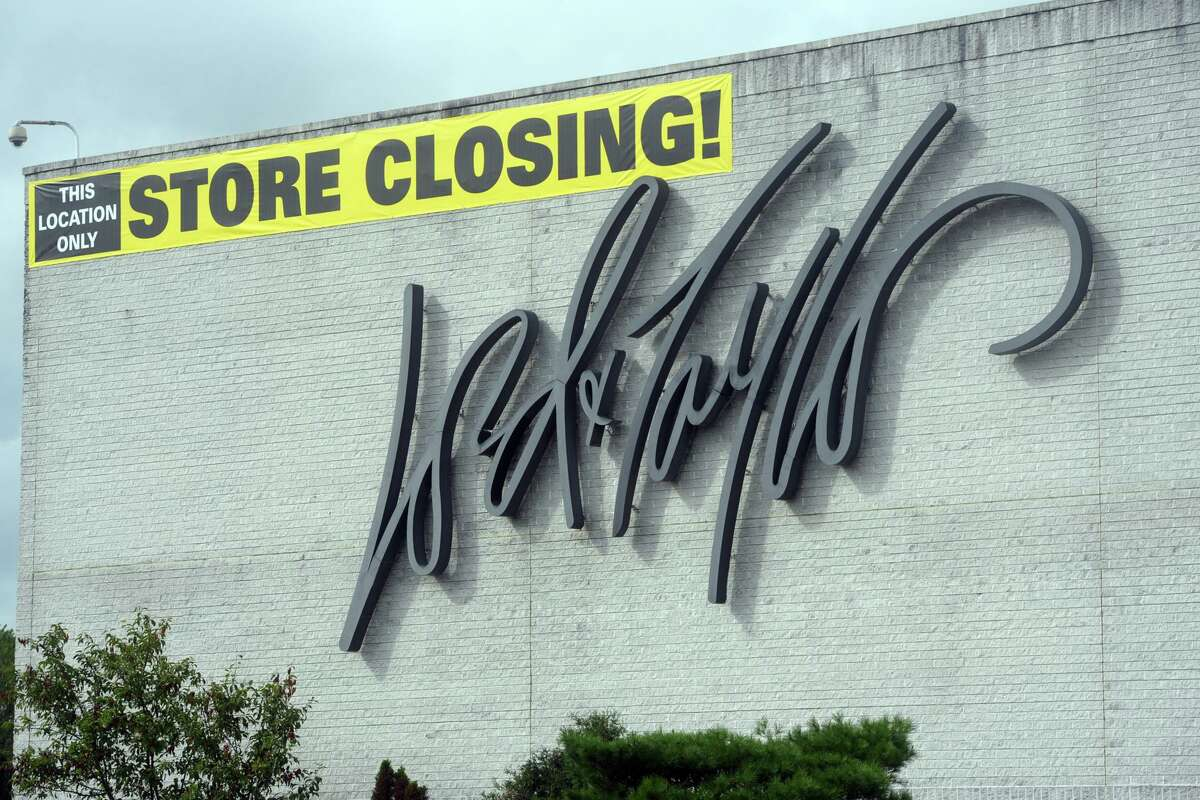 A store closing sign hangs on the exterior of the Lord + Taylor store at the Westfield Trumbull mall in Trumbull, Conn., on Sept. 1, 2020.