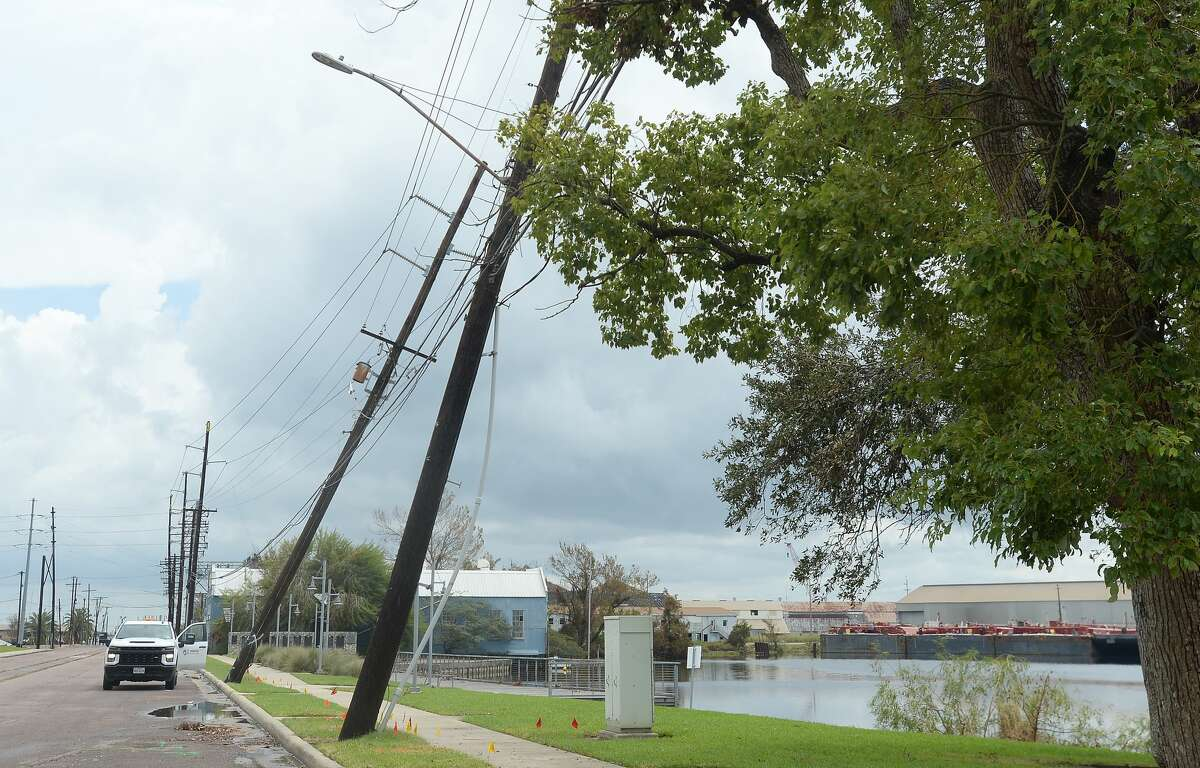 Power poles lean on Front Street in Orange, a week after the area was hit with some of the most severe damage in Southeast Texas by Hurricane Laura. Photo taken Thursday, September 3, 2020 Kim Brent/The Enterprise