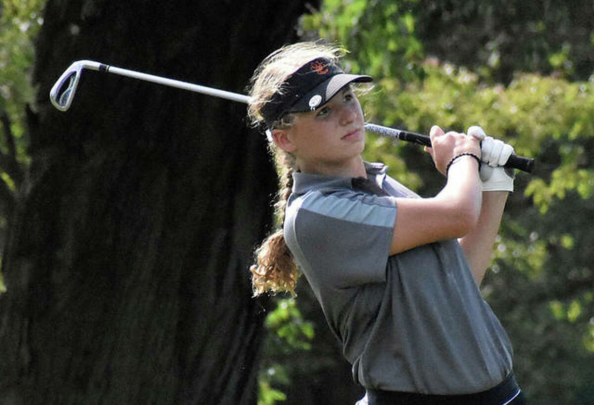 Edwardsville's Morgan Landry watches her tee shot on No. 9 during Thursday's dual match against O'Fallon.
