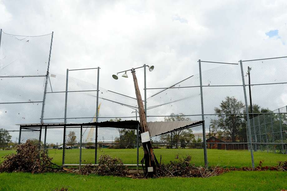 A snapped stadium light pole rests atop a dugout cover in Simmons Field in Orange a week after the area was hit with some of the most severe damage in Southeast Texas by Hurricane Laura. Photo taken Thursday, September 3, 2020 Kim Brent/The Enterprise Photo: Kim Brent/The Enterprise