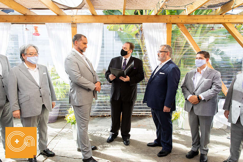 David and Devlin were married in August at the Leland Tea Garden in Burlingame, Calif. Their wedding was livestreamed for wedding guests across the country. Photo: Shelley Anderson, Cage & Aquarium