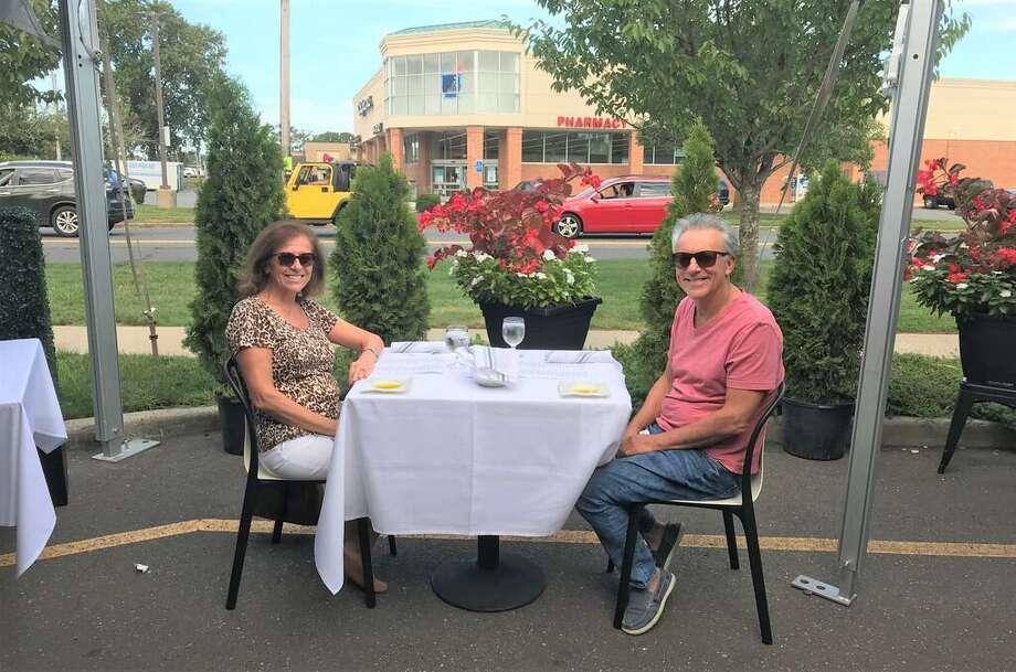 Demetra Ballis and husband James with an appetizer at Bin 100. Photo: Bill Bloxsom