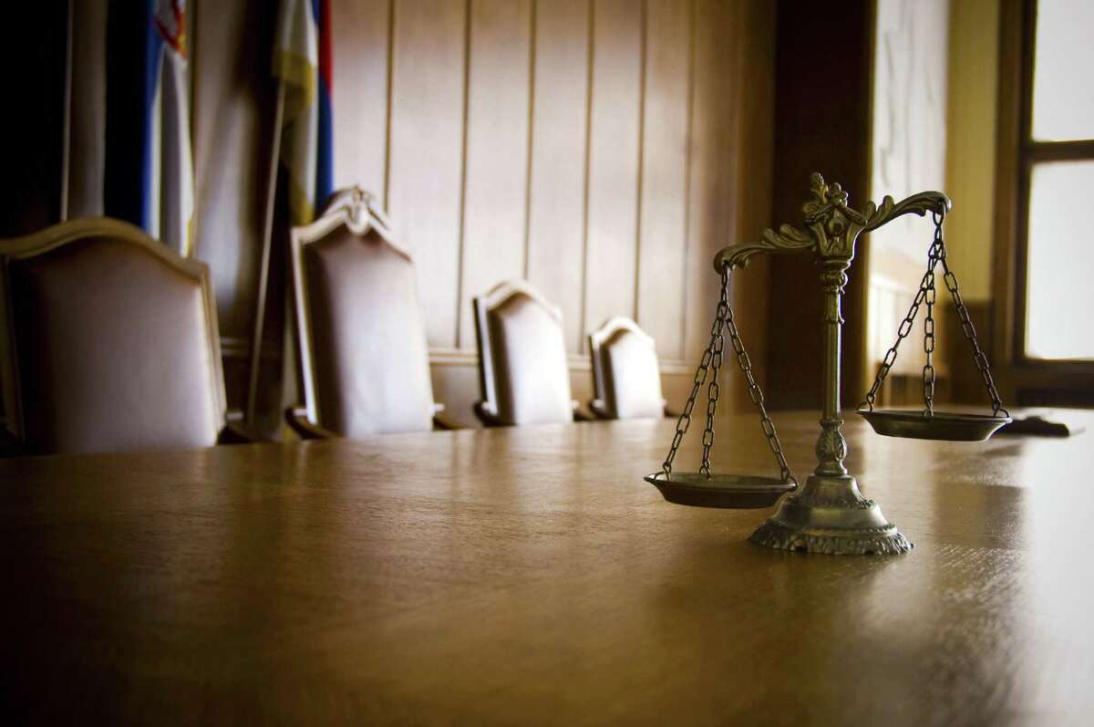 File photo of the scales of justice in an empty courtroom.