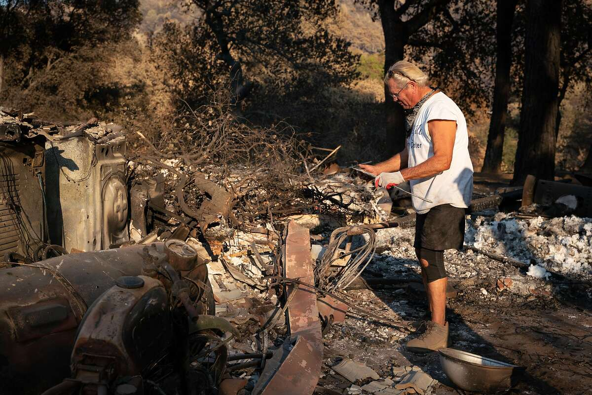 """Jim Campbell, 68, sifts through remaining debris of his property destroyed by the Hennessey Fire on Pleasants Valley Road in Vacaville, Calif. on Thursday, Sept. 3, 2020. """"None of our animals were hurt and that is a miracle,"""" said Campbell who has lived at the property for over 12 years."""