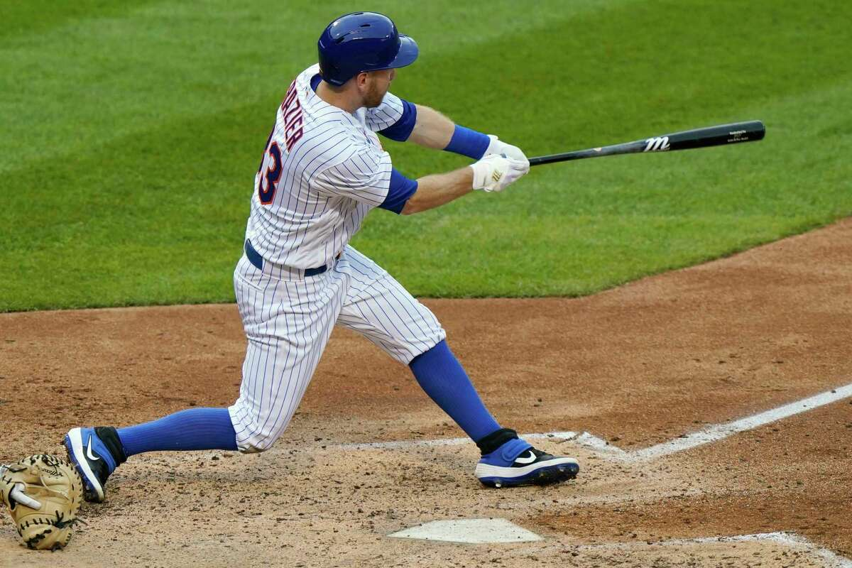 New York Mets' Todd Frazier hits a double during the fourth inning of the team's baseball game against the New York Yankees, Thursday, Sept. 3, 2020, in New York. (AP Photo/Kathy Willens)