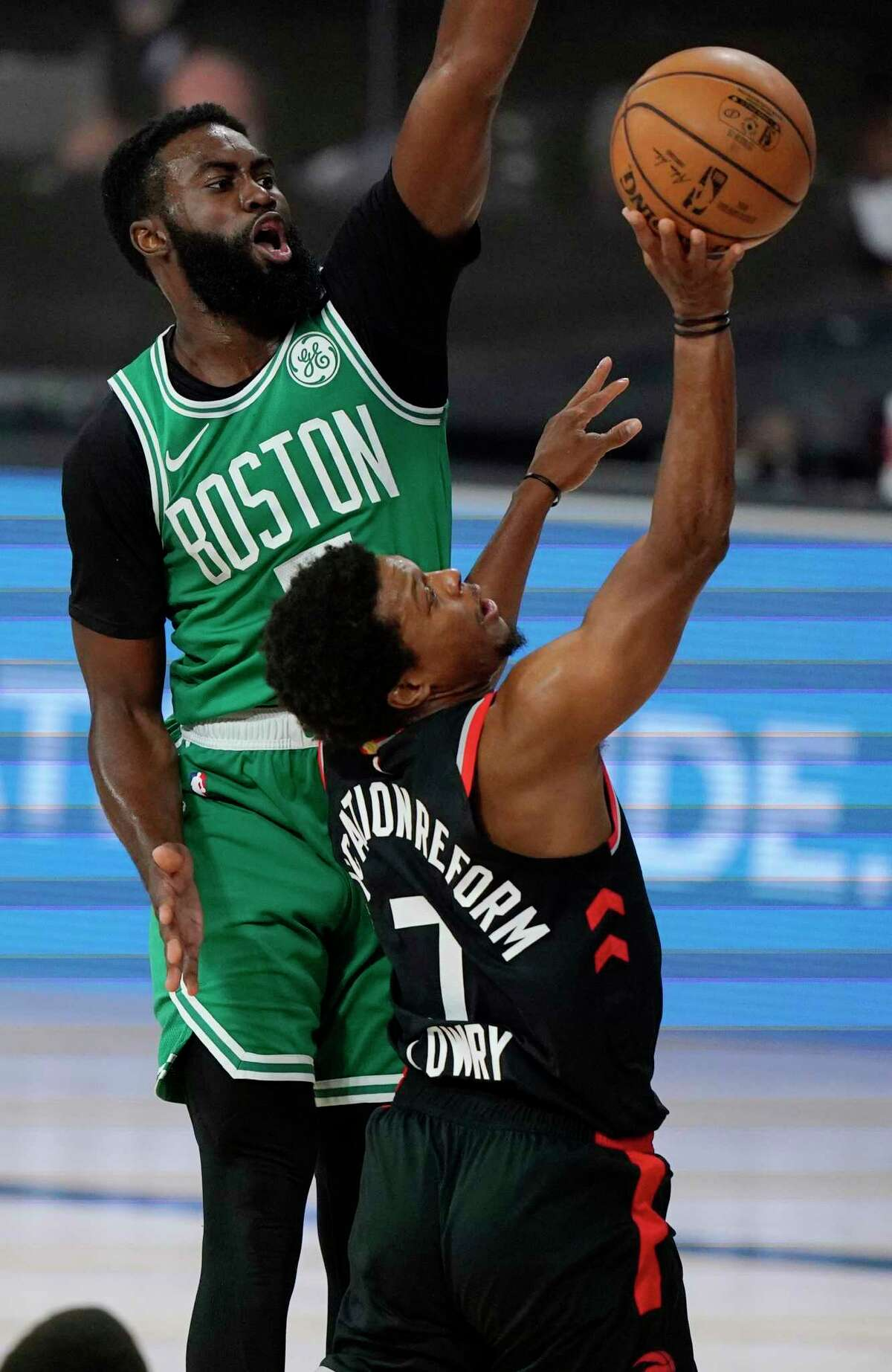 Toronto Raptors' Kyle Lowry (7) shoots in front of Boston Celtics' Jaylen Brown, left, in the first half of an NBA conference semifinal playoff basketball game Thursday, Sept 3, 2020, in Lake Buena Vista Fla. (AP Photo/Mark J. Terrill)